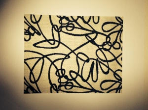 This fabric is so chic and lovely. We got about 2 inches and matted it down with a white mat frame for some wall art.